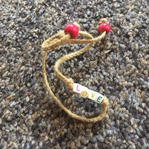 "NWOT ""LOVE"" Beaded Tie Bracelet"